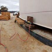 Preparing to raise the tank using air bag methodology,