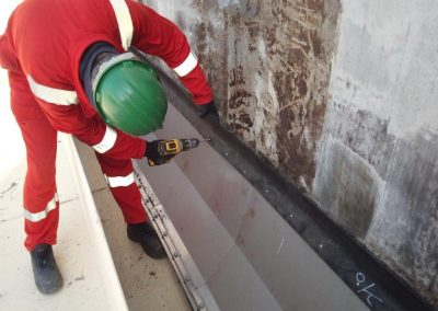 Removal and replacement of the existing protective coating on the tank bottom